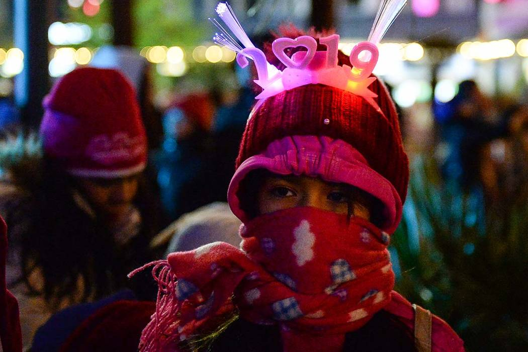 Ingrid Negrete, 10, from San Diego bundles up for the cold weather on New Year's Eve on the Las Vegas Strip, Monday, Dec. 31, 2018. (Caroline Brehman/Las Vegas Review-Journal)