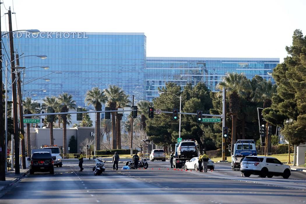 Las Vegas police investigate at Paradise Road near Corporate Drive in Las Vegas Tuesday, Jan. 1, 2018, where an officer was struck by a suspected DUI driver. (K.M. Cannon/Las Vegas Review-Journal) ...
