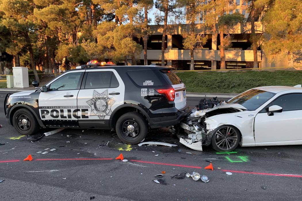 A suspected DUI driver crashed into a Las Vegas police motorcycle and police SUV, injuring two officers, on Paradise Road near Corporate Drive, Tuesday, Jan. 1, 2019. (Twitter/Las Vegas Metropolit ...
