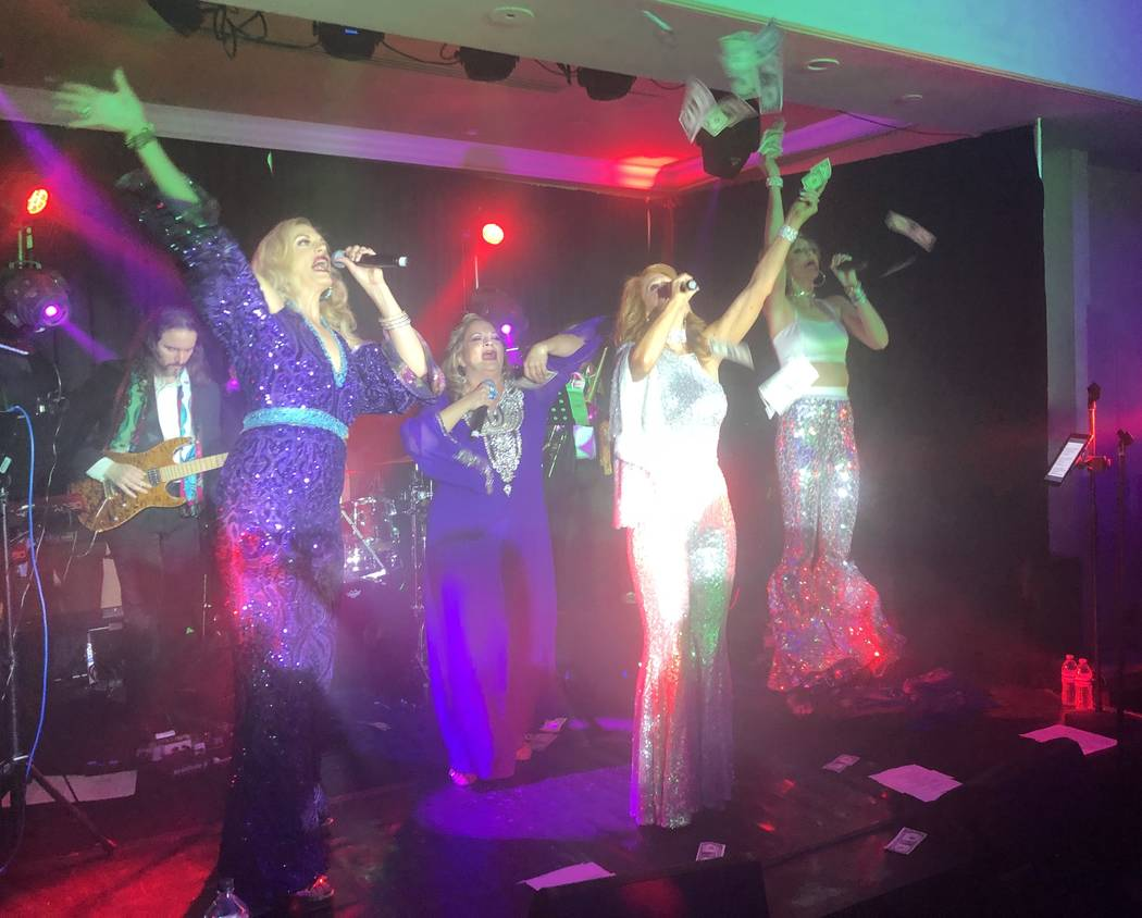The ABBA-styled act featuring Kelly Clinton-Holmes, Kirbi Long, Ashley Fuller and Elisa Fiorillo is shown shown at the club's re-opening party at Turnbery Place on Dec. 31, 2018. (John Katsilomet ...