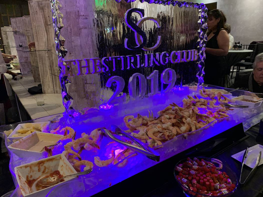 Shrimp and an ice sculpture are shown at the re-opening party at Stirling Club at Turnbery Place on Dec. 31, 2018. (Mat Luschek/Las Vegas Review-Journal)