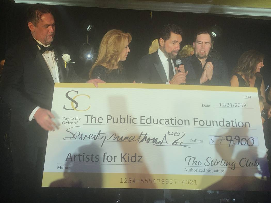 Clint Holmes and Kelly Clinton-Holmes, flanked by Stirling Club Chief Operating Officer Michael Stapleton, far left, are shown accepting a $79,000 check from club owner Richard Ditton for Artists ...