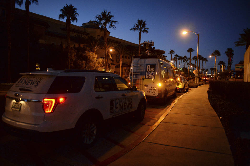 Local news station vans line up after reports of a shooting at Green Valley Ranch casino in Henderson, Nev., Tuesday, Jan. 1, 2019. (Caroline Brehman/Las Vegas Review-Journal via AP)