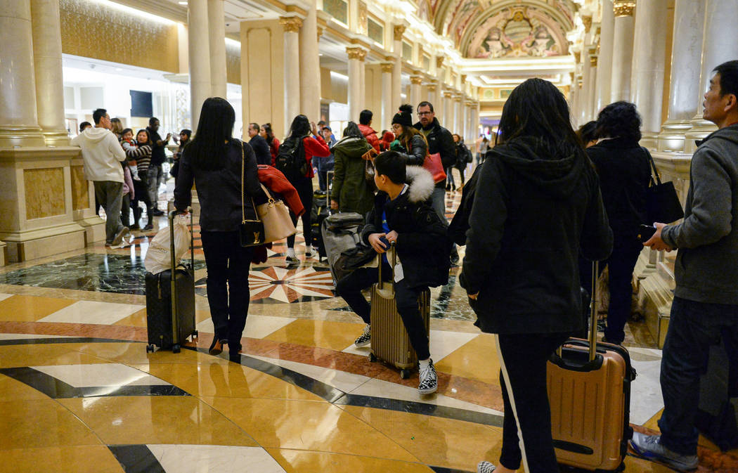 Long lines of people wait to check out at The Venetian in Las Vegas, Tuesday, Jan. 1, 2019. Caroline Brehman/Las Vegas Review-Journal