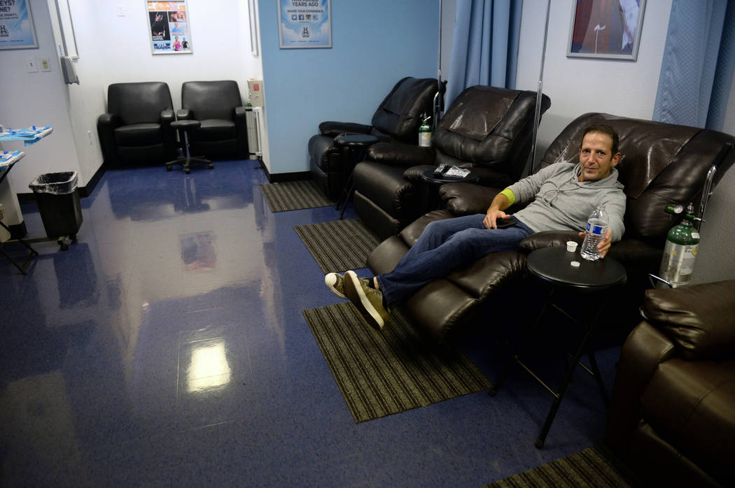 Todd Reale from Brooklyn sits after receiving treatment at Hangover Heaven in Las Vegas, Tuesday, Jan. 1, 2019. Caroline Brehman/Las Vegas Review-Journal