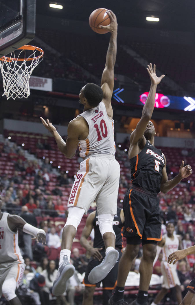 UNLV senior forward Shakur Juiston (10) elevates for a dunk over Pacific senior forward Anthony Townes (5) in the first half on Tuesday, Nov. 20, 2018, at the Thomas & Mack Center, in Las Vega ...