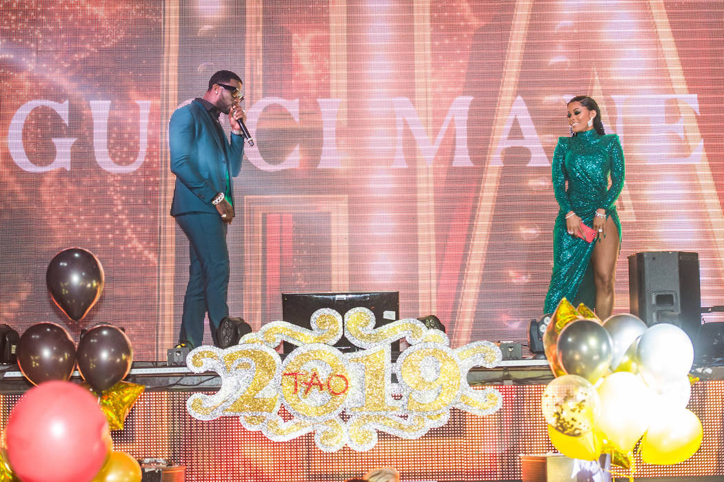 Gucci Mane and his wife, Keyshia Ka'Oir, are shown counting down to 2019 at Tao inside the Venetian. (Brenton Ho/Global Media Group).