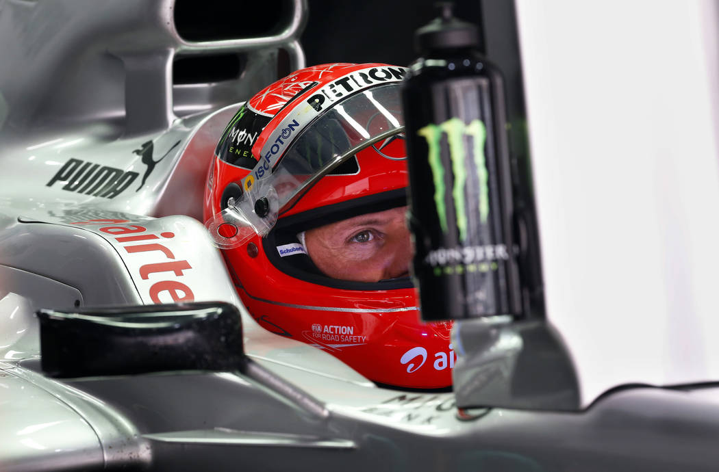 FILE - In this Oct. 27, 2012, file photo, Mercedes driver Michael Schumacher of Germany waits in his car during the third practice session for the Indian Formula One Grand Prix at the Buddh Intern ...