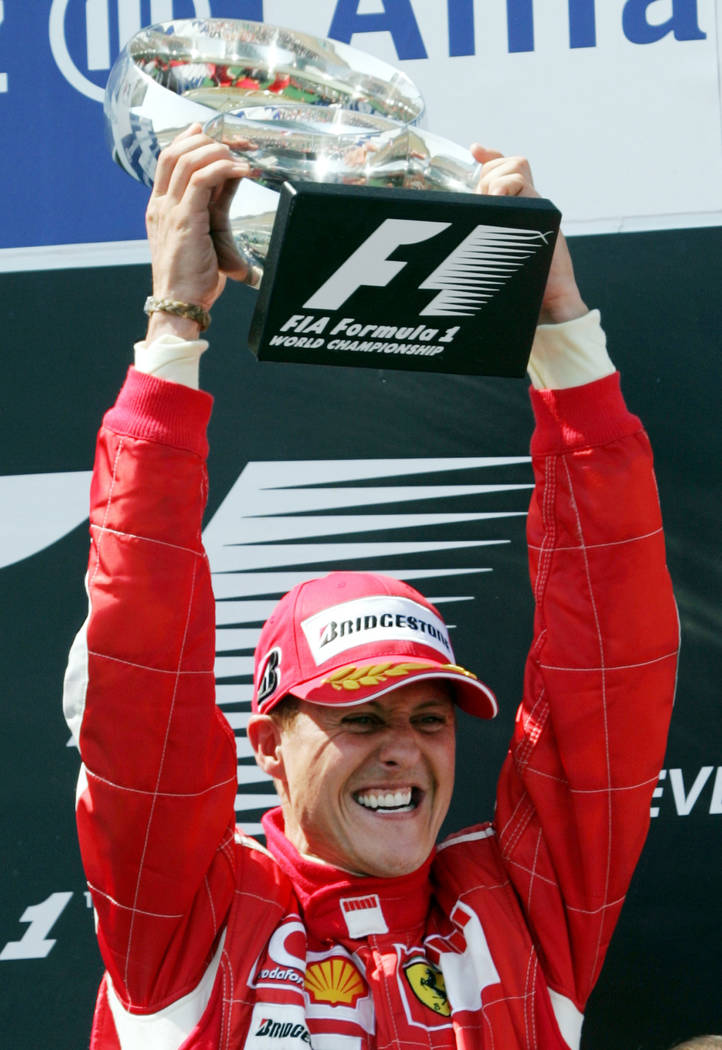 In this July 16, 2006 file photo, Ferrari's F1 driver Michael Schumacher, of Germany, raises the trophy after winning the French Formula One Grand Prix at the Magny-Cours circuit, central France. ...