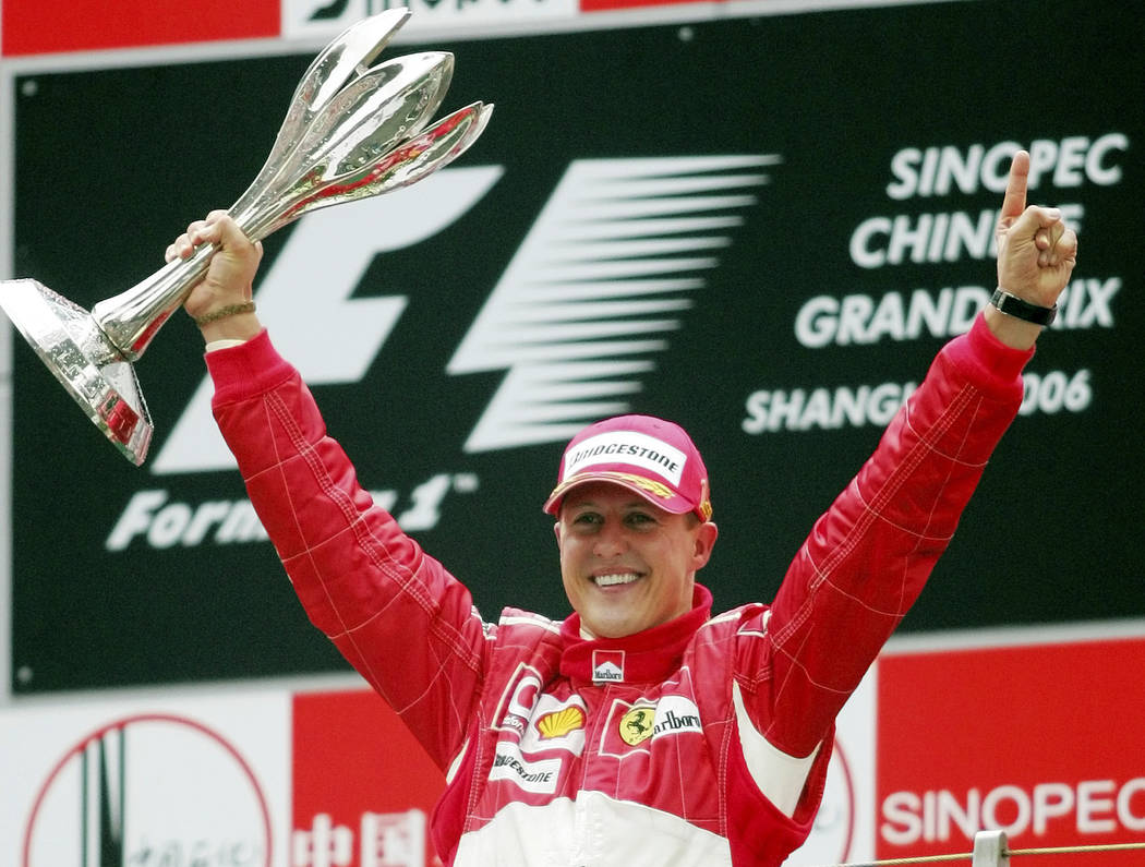 In this Oct. 1, 2006 file photo, Germany's Michael Schumacher celebrating winning the Formula One Chinese Grand Prix auto race at the Shanghai International Circuit in Shanghai, China. (AP Photo/G ...