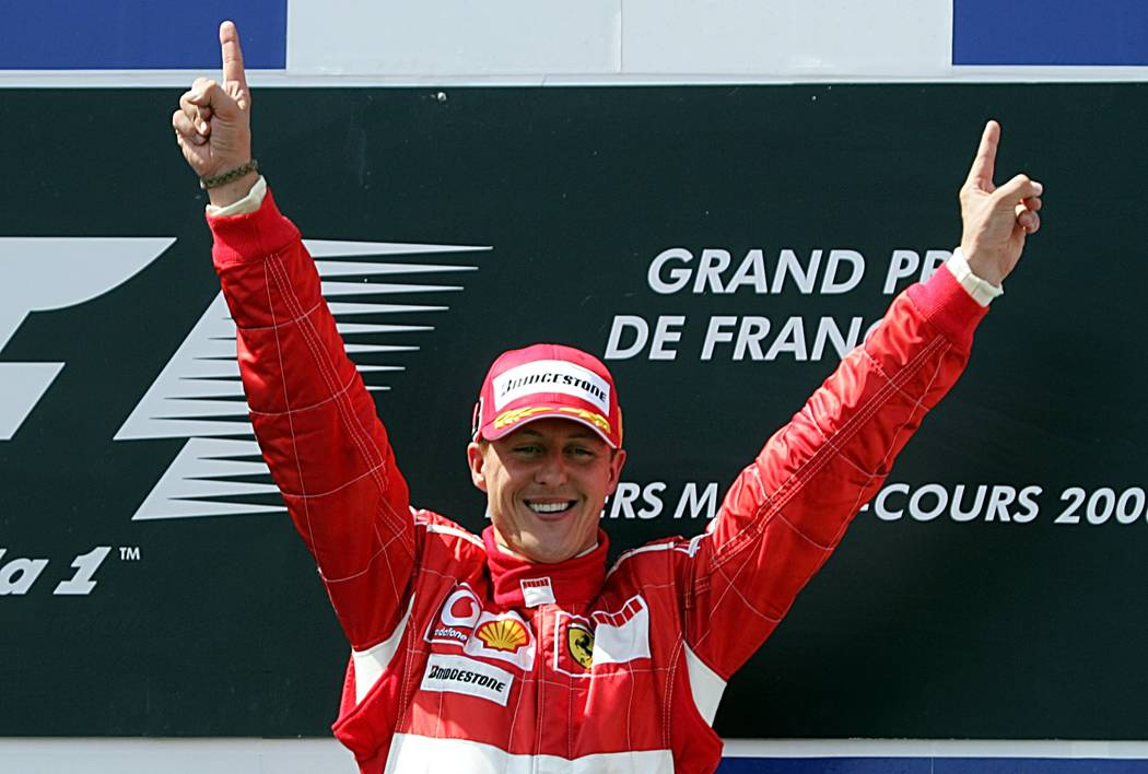 Ferrari Formula One driver Michael Schumacher of Germany celebrates his victory at the French Formula One Grand Prix on the Magny-Cours circuit, central France, Sunday July 16, 2006.(AP Photo/R ...