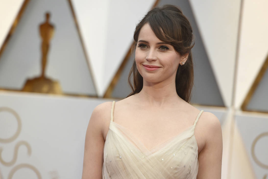 Felicity Jones arrives at the Oscars on Sunday, Feb. 26, 2017, at the Dolby Theatre in Los Angeles. (Photo by Jordan Strauss/Invision/AP)