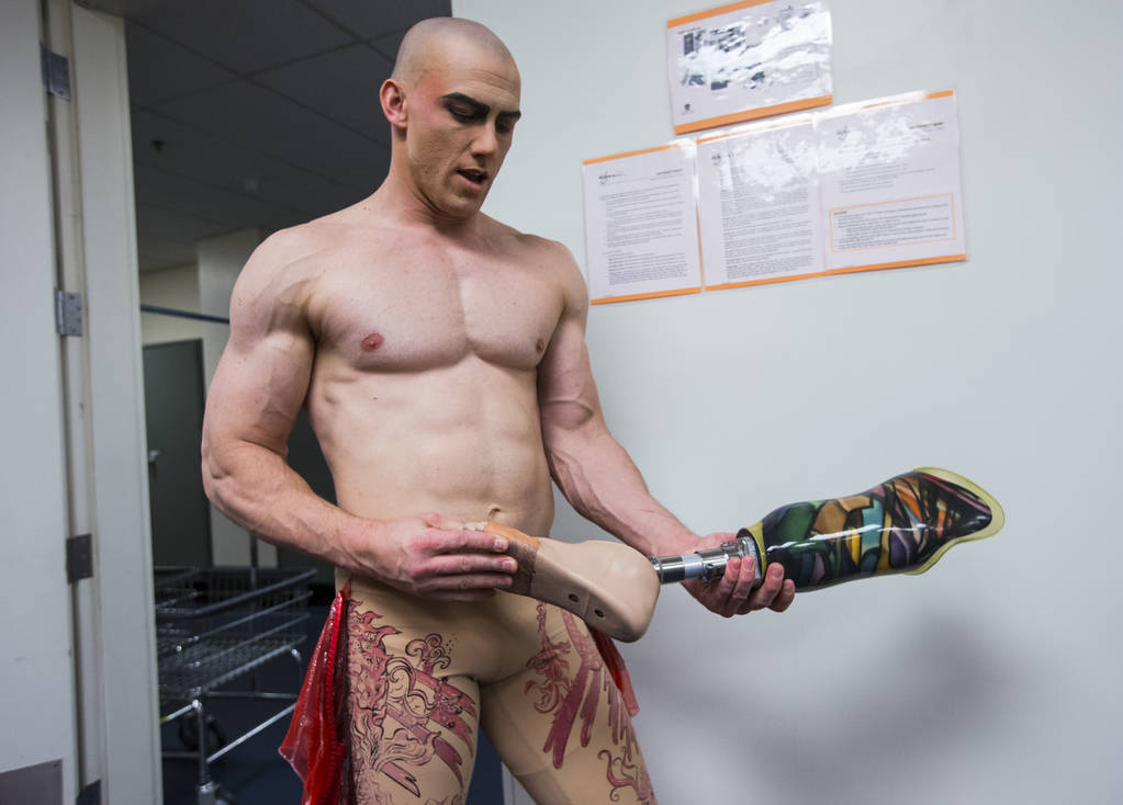 "AJ Montgomery, an acrobat in ""Le Reve,"" holds one of the prosthetic legs he uses in show at Wynn Las Vegas in Las Vegas on Tuesday, Dec. 18, 2018. Montgomery, an amputee, performs using ..."