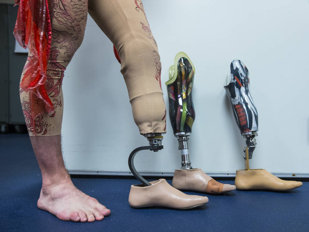 "AJ Montgomery, an acrobat in ""Le Reve,"" stands with the different prosthetic legs he uses to perform in the show at Wynn Las Vegas in Las Vegas on Tuesday, Dec. 18, 2018. Chase Stevens L ..."