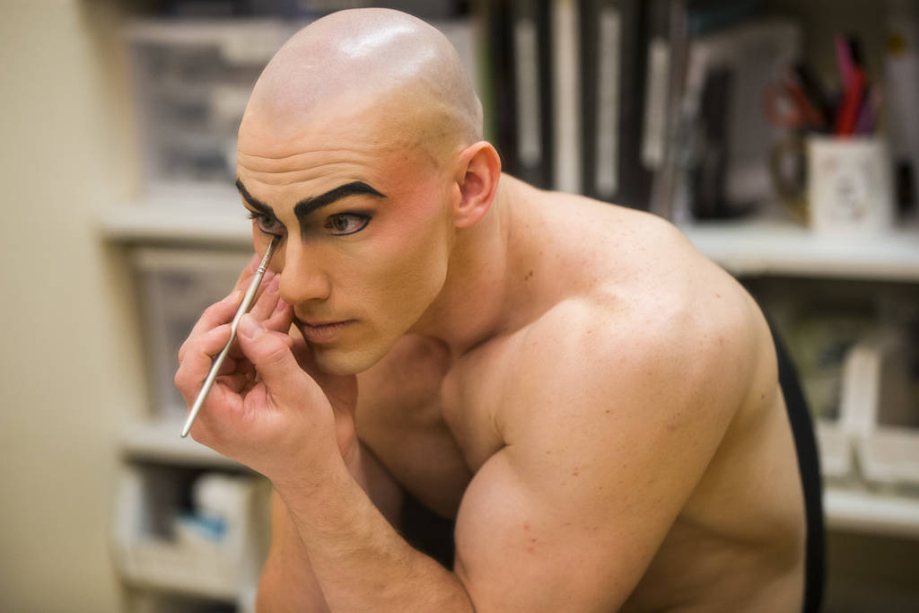 "AJ Montgomery, an acrobat in ""Le Reve,"" applies makeup while getting ready for the evening's performance at Wynn Las Vegas in Las Vegas on Tuesday, Dec. 18, 2018. Montgomery, an amputee, ..."