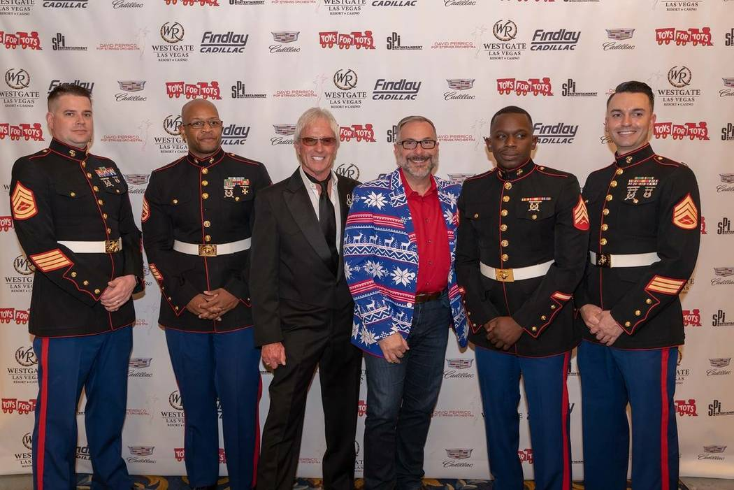 The 10th annual Findlay Cadillac-sponsored Toys for Tots concert was a huge success at the Westgate's International Theater. From left, Gunnery Sgt. Will Ryder; Staff Sgt. Dale Humble; Findlay Cad ...