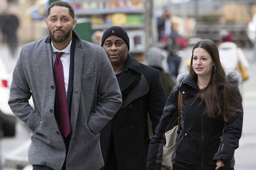 Former Southern California assistant basketball coach Tony Bland, left, arrives at federal court in New York, Wednesday, Jan. 2, 2019. Bland plead guilty in a criminal case in which prosecutors sa ...