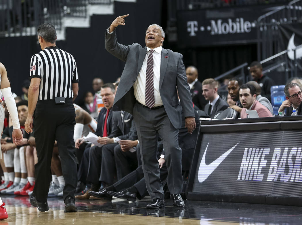 UNLV Rebels head coach Marvin Menzies yells at his players during the second half of an NCAA college basketball game against the Brigham Young Cougars at T-Mobile Arena in Las Vegas on Saturday, D ...
