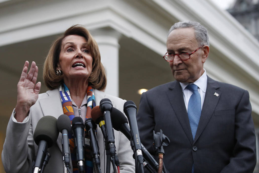 House Democratic leader Nancy Pelosi of California, left, the House Speaker-designate, and Senate Minority Leader Chuck Schumer, D-N.Y., speak to the media after meeting with President Donald Trum ...