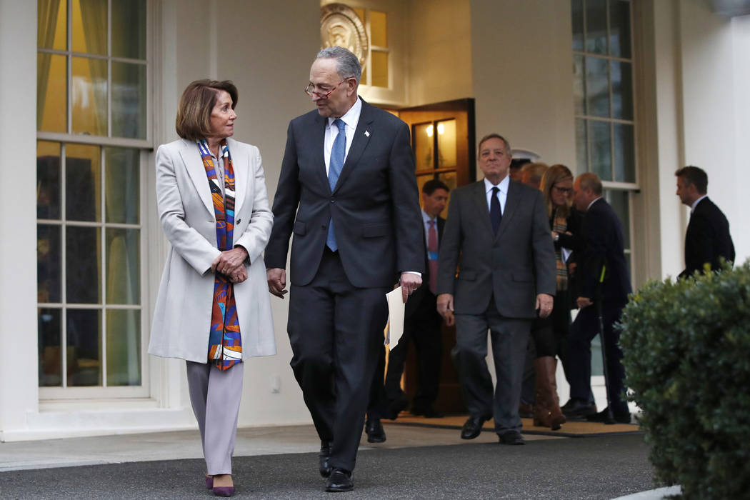 House Democratic leader Nancy Pelosi of California, left, walks with Senate Minority Leader Chuck Schumer, D-N.Y., as Democratic leaders including Sen. Dick Durbin, D-Ill., at right, arrive to spe ...