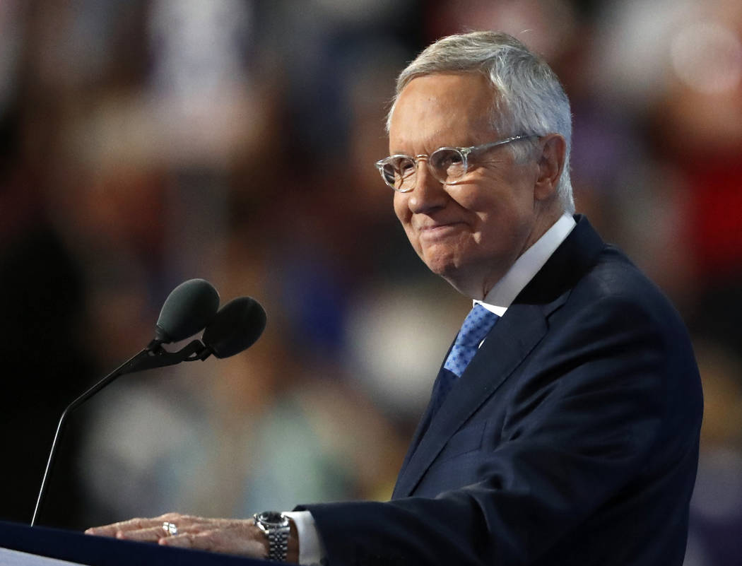 Senate Minority Leader Harry Reid of Nevada smiles from the podium as he speaks during the third day of the Democratic National Convention in Philadelphia , Wednesday, July 27, 2016. (Paul Sancya/AP)