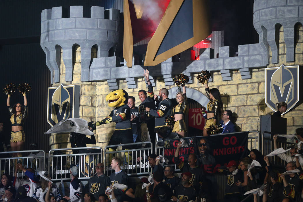 Wayne Newton raises his hand during the pregame show for Game 4 of the Western Conference Final between the Vegas Golden Knights and Winnipeg Jets at T-Mobile Arena in Las Vegas, Friday, May 18, 2 ...