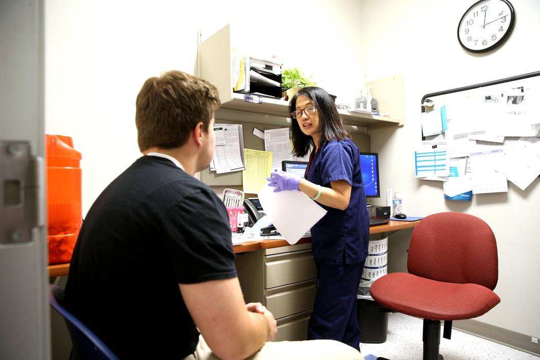 Senior Community Health Nurse Jocelyn Castillo prepares to give Cole Nisson, 18, of Henderson a flu shot at the Southern Nevada Health District in Las Vegas office Wednesday, Jan. 2, 2019. K.M. Ca ...