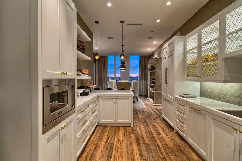 Professional grade appliances, walk-in pantry and casual bar dining complete the kitchen area. (Award Realty)