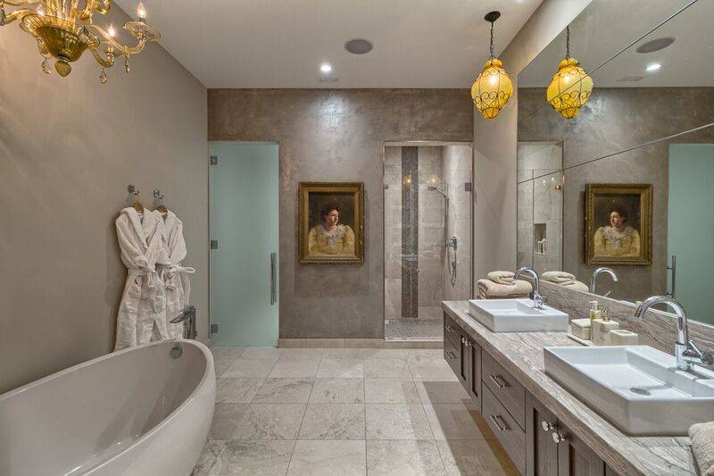 The master bath in penthouse 4702 features an oversized soaking tub, radiant heated marble flooring, custom floating vanity and imported tile in the shower. (Award Realty)
