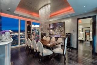 A custom chandelier by designer Todd Rugee cascades down from the coffered ceiling, creating a stunning focal point for the formal dining. (Luxury Estates International)