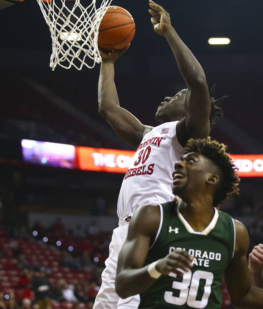 UNLV Rebels forward Jonathan Tchamwa Tchatchoua (30) goes to the basket past Colorado State guard Kris Martin (30) during the first half of a basketball game at the Thomas & Mack Center in Las ...