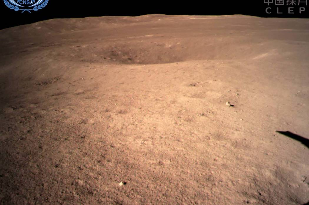 In this photo provided Jan. 3, 2019, by China National Space Administration via Xinhua News Agency, the first image of the moon's far side taken by China's Chang'e-4 probe. (China National Space ...