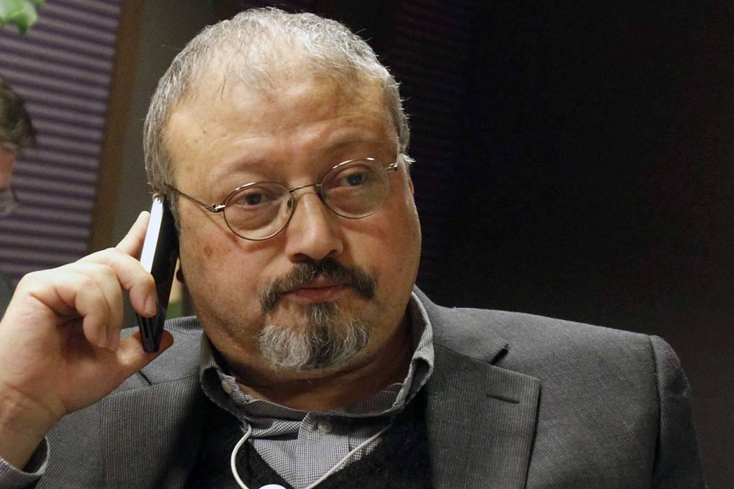 In this Jan. 29, 2011 file photo, Jamal Khashoggi speaks on his cellphone at the World Economic Forum in Davos, Switzerland. (AP Photo/Virginia Mayo, file)