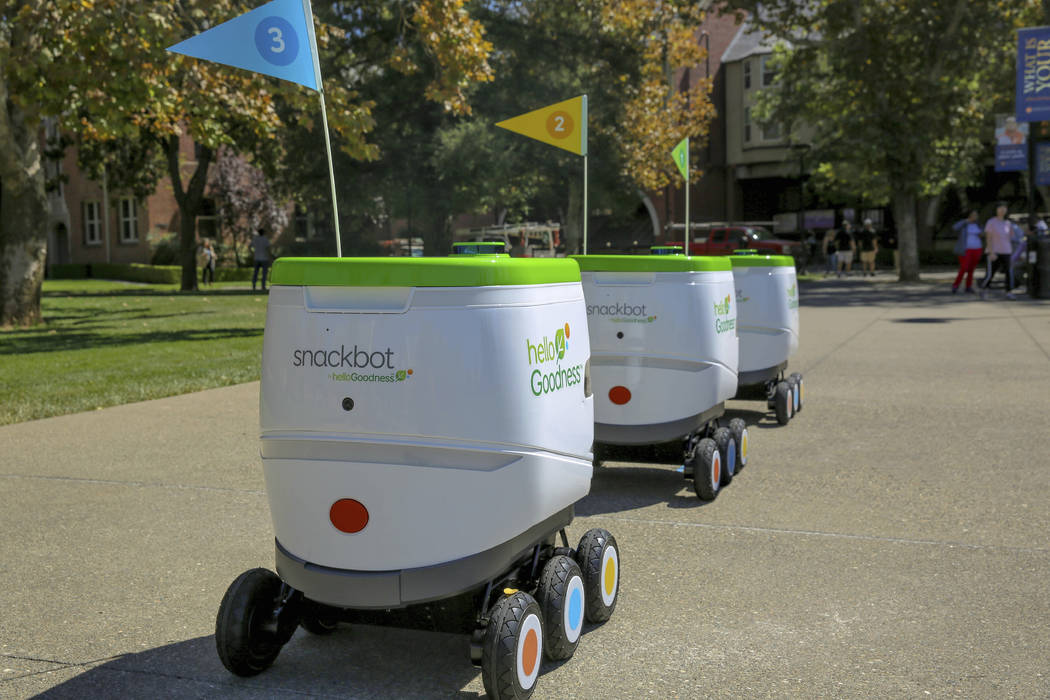 This undated photo provided by PepsiCo shows self-driving robots made by Robby Technologies. PepsiCo says it will start making snack deliveries with the robots on Thursday, Jan. 3, 2019, at the Un ...