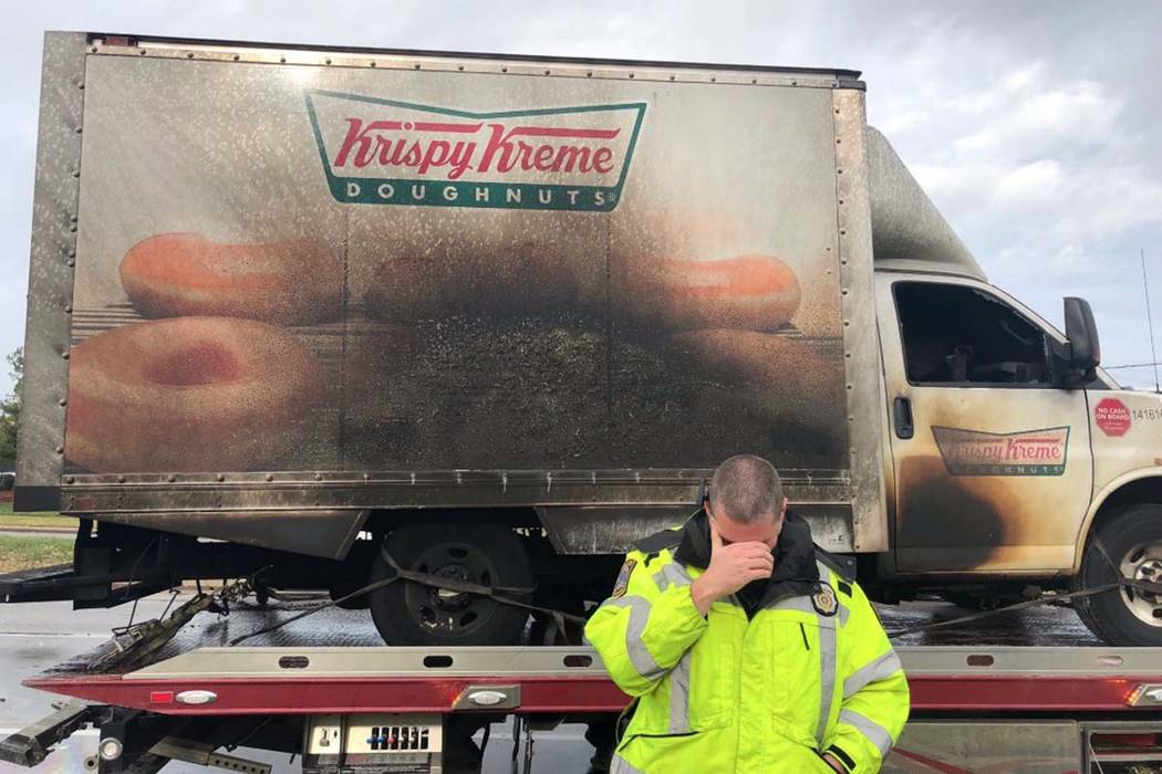 Lexington police posted photos on social media of the blackened side of the truck and officers jokingly mourning the truck's loss. (@lexkypolice/Twitter)