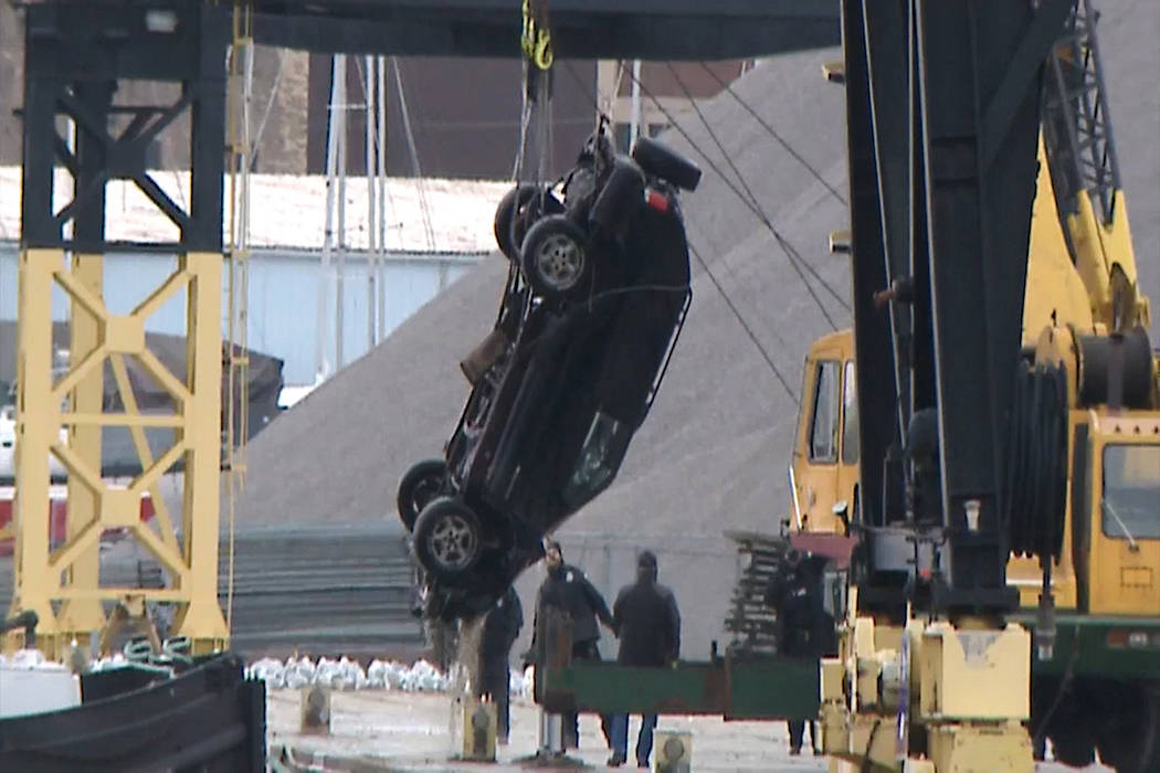 This Jan. 1, 2019 screen shot from WISN-TV shows authorities pulling out an SUV from the Kinnickinnic River, a day after it ended up there during a police chase. A 2-year-old girl, a 19-year-old w ...
