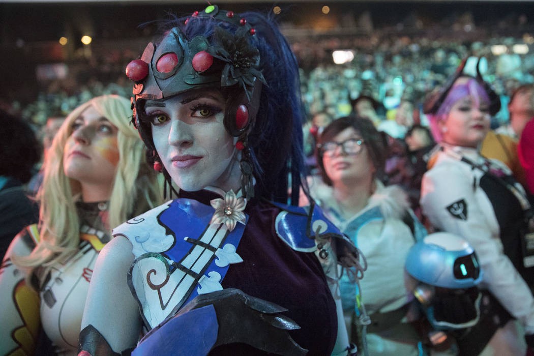 In this July 28, 2018 file photo, cosplayer fans watch the competition between Philadelphia Fusion and London Spitfire during the Overwatch League Grand Finals competition, at Barclays Center in t ...