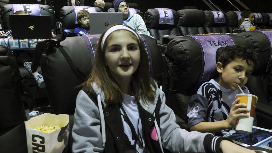 """In this photo provided by Super League Gaming, Ella Lasky, 12, participates in a """"Minecraft"""" esports competition at a Super League Gaming event in White Plains, New York. Lasky hopes ..."""