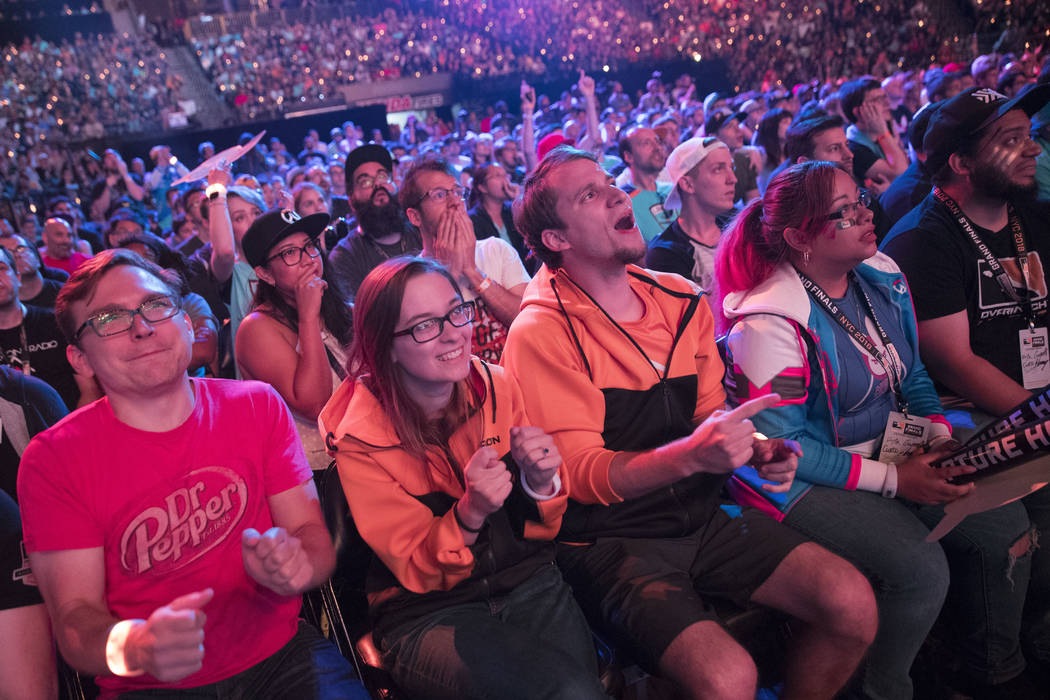In this July 28, 2018 file photo, Philadelphia Fusion fans react as the London Spitfire takes the lead during the Overwatch League Grand Finals competition at Barclays Center in the Brooklyn borou ...