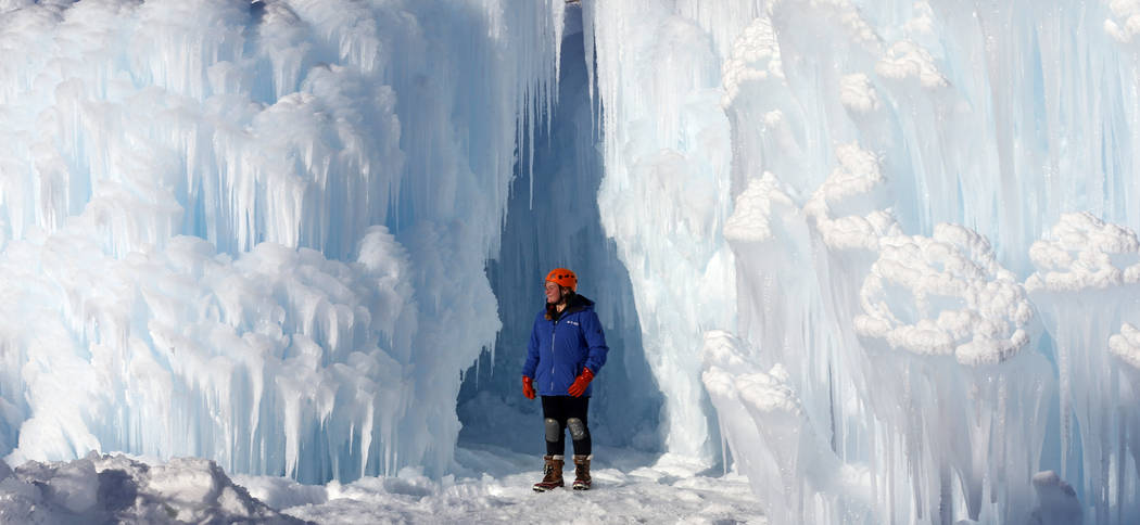 Midway Ice Castles take shape as artisans construct popular winter attraction Wednesday, Jan. 2, 2019, in Midway, Utah. A winter storm has covered cactus with snow in parts of the American Southwe ...