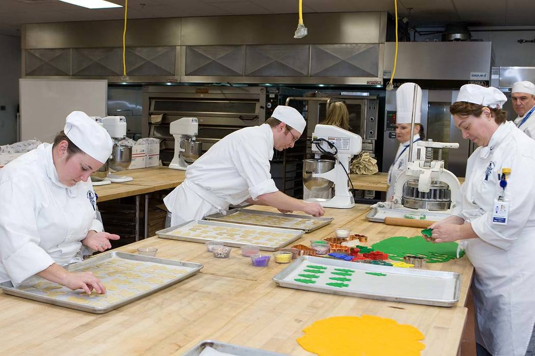Chefs and students at Le Cordon Bleu College of Culinary Arts cut out and decorate holiday cookies that will be delivered by Nellis Air Force Base to American soldiers serving in Iraq and Afghanis ...