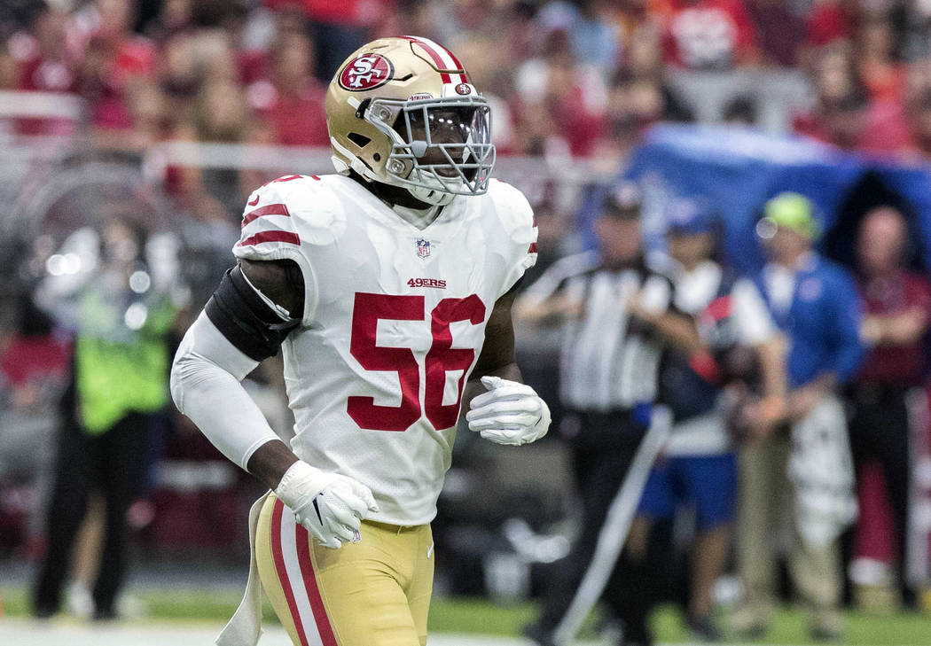 In this Oct. 28, 2018, file photo, San Francisco 49ers' Reuben Foster (56) jogs on the field during the first half of an NFL football game against the Arizona Cardinals in Glendale, Ariz. (AP Pho ...
