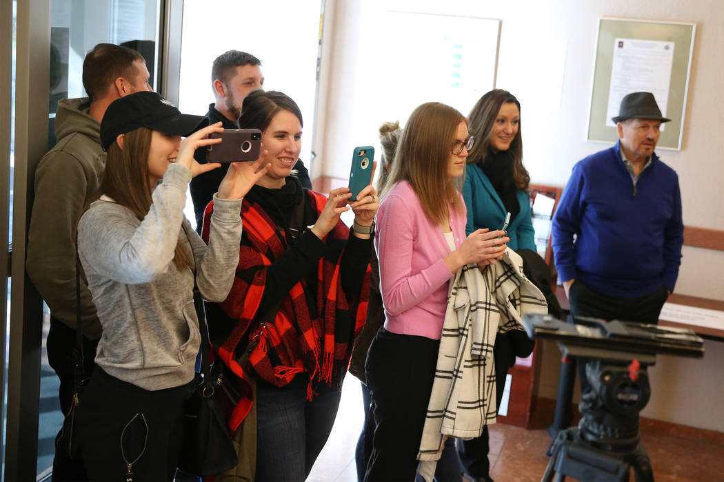 Friends and family takes pictures of Jared Duval and his wife, Brooke Siegert, not pictured, of Still Water, Minn., after receiving their wedding vow renewal certificate at the Marriage License Bu ...