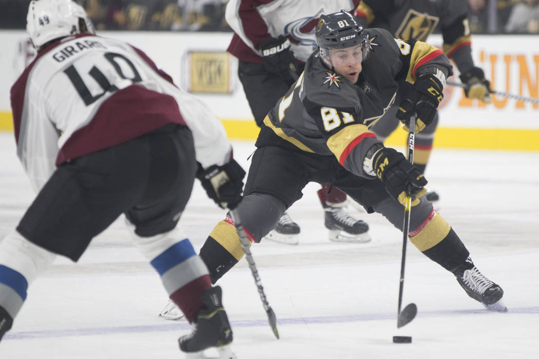 Golden Knights center Jonathan Marchessault (81) fights for a loose puck with Colorado Avalanche defenseman Samuel Girard (49) in the first period on Thursday, Dec. 27, 2018, at T-Mobile Arena, in ...