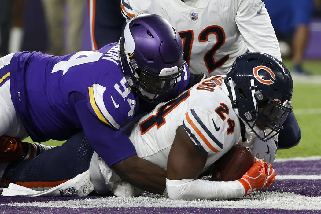 Chicago Bears running back Jordan Howard (24) scores on a 1-yard touchdown run ahead of Minnesota Vikings defensive tackle Jaleel Johnson (94) during the first half of an NFL football game, Sunday ...