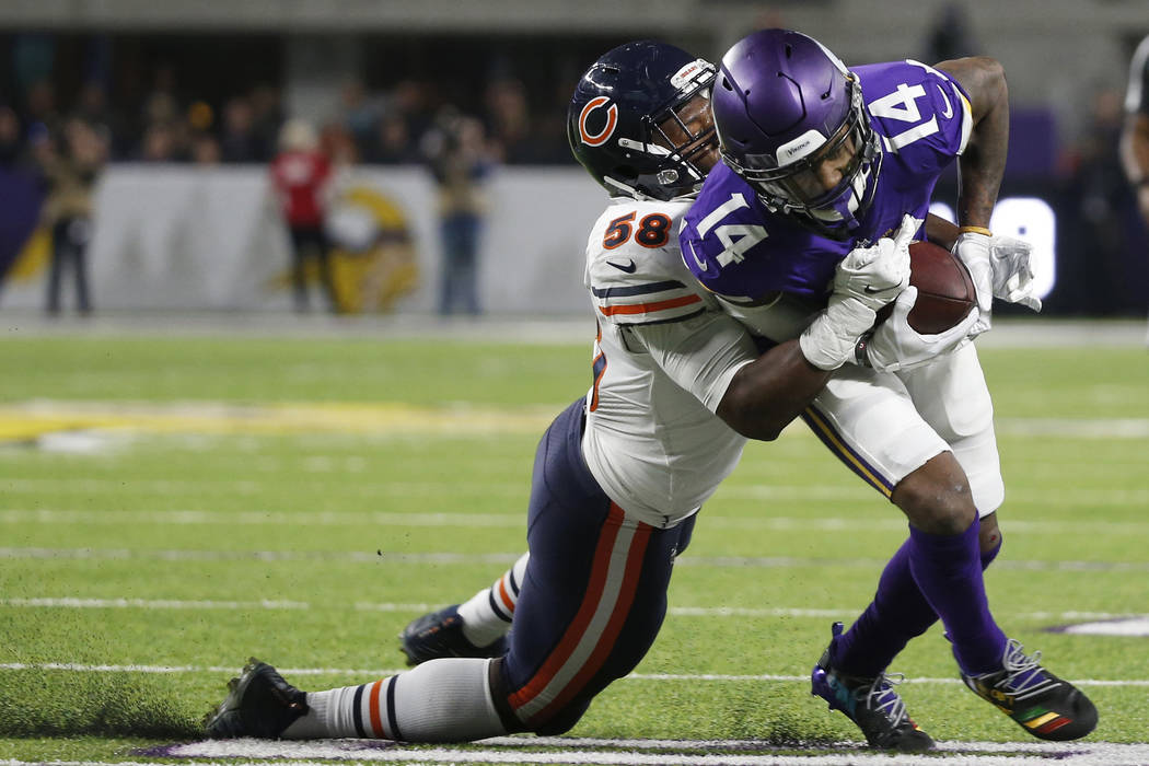Minnesota Vikings wide receiver Stefon Diggs (14) tries to break a tackle by Chicago Bears inside linebacker Roquan Smith, left, during the second half of an NFL football game, Sunday, Dec. 30, 20 ...