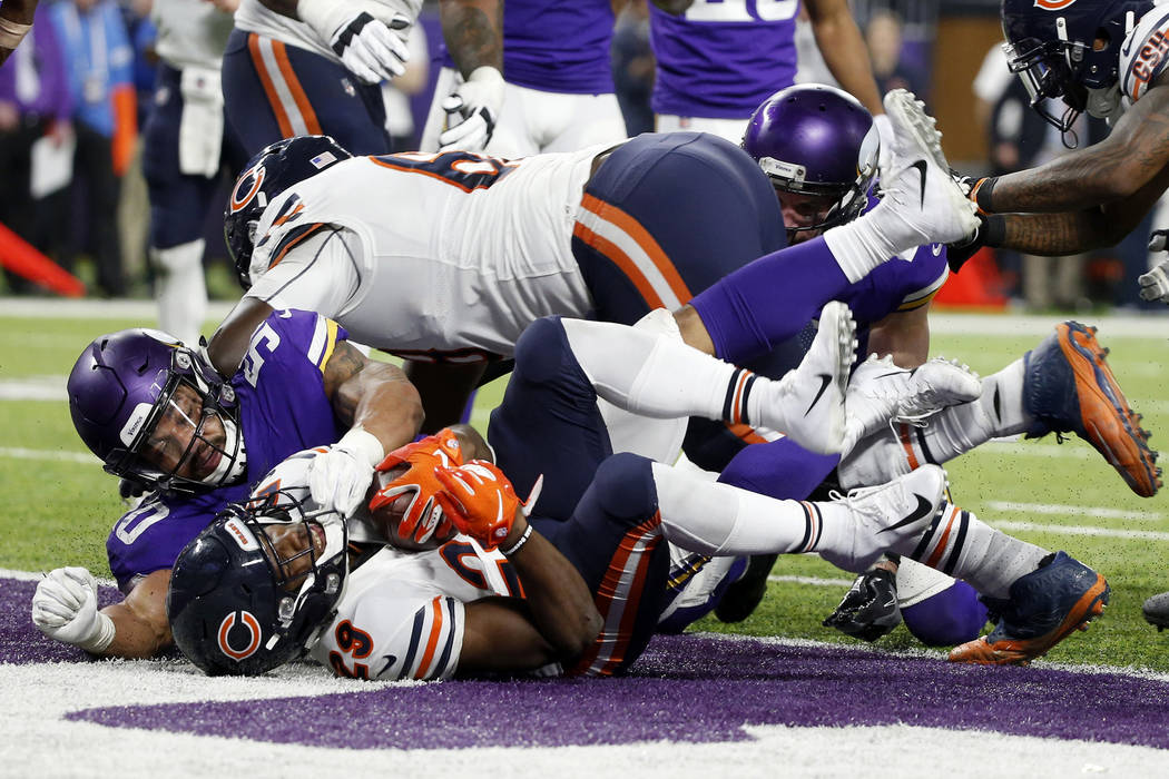 Chicago Bears running back Tarik Cohen (29) scores on a 3-yard touchdown run ahead of Minnesota Vikings linebacker Eric Wilson (50) during the second half of an NFL football game, Sunday, Dec. 30, ...