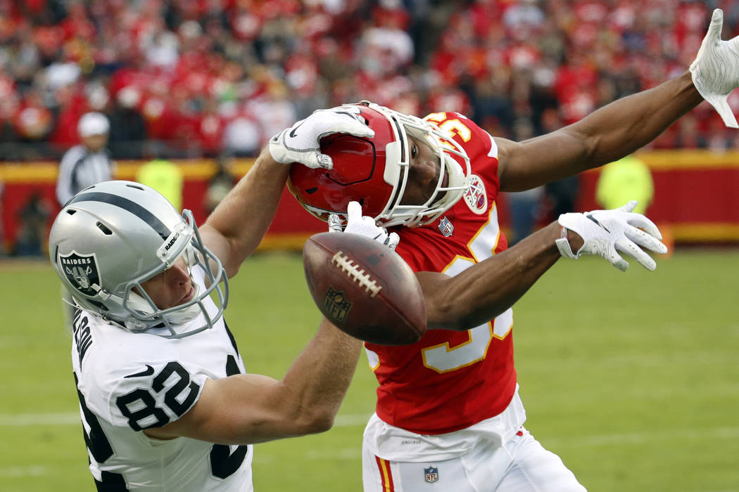 Kansas City Chiefs cornerback Charvarius Ward (35) breaks up a pass intended for Oakland Raiders wide receiver Jordy Nelson (82) during the first half of an NFL football game in Kansas City, Mo., ...