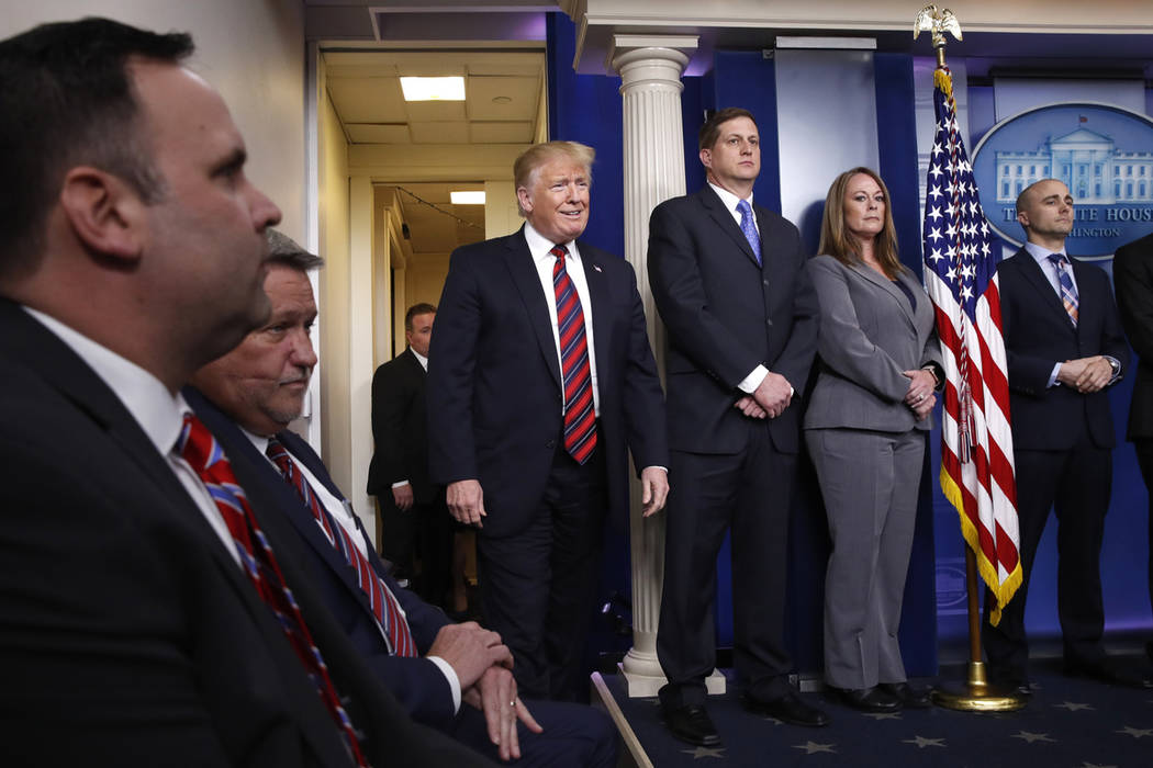 President Donald Trump arrives in a surprise appearance to speak about border security, Thursday Jan. 3, 2019, in the briefing room of the White House in Washington. (AP Photo/Jacquelyn Martin)