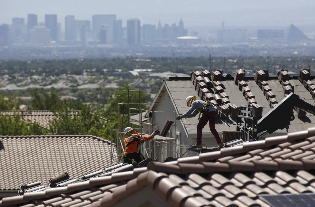 Construction workers set bundles of tile on the roof of an under-construction house in the master-planned community of Summerlin in Las Vegas on Saturday, June 30, 2018. Richard Brian Las Vegas Re ...